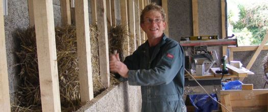 Constructing the wood wool and straw bale sandwich to insulate Balebarn Ecolodge